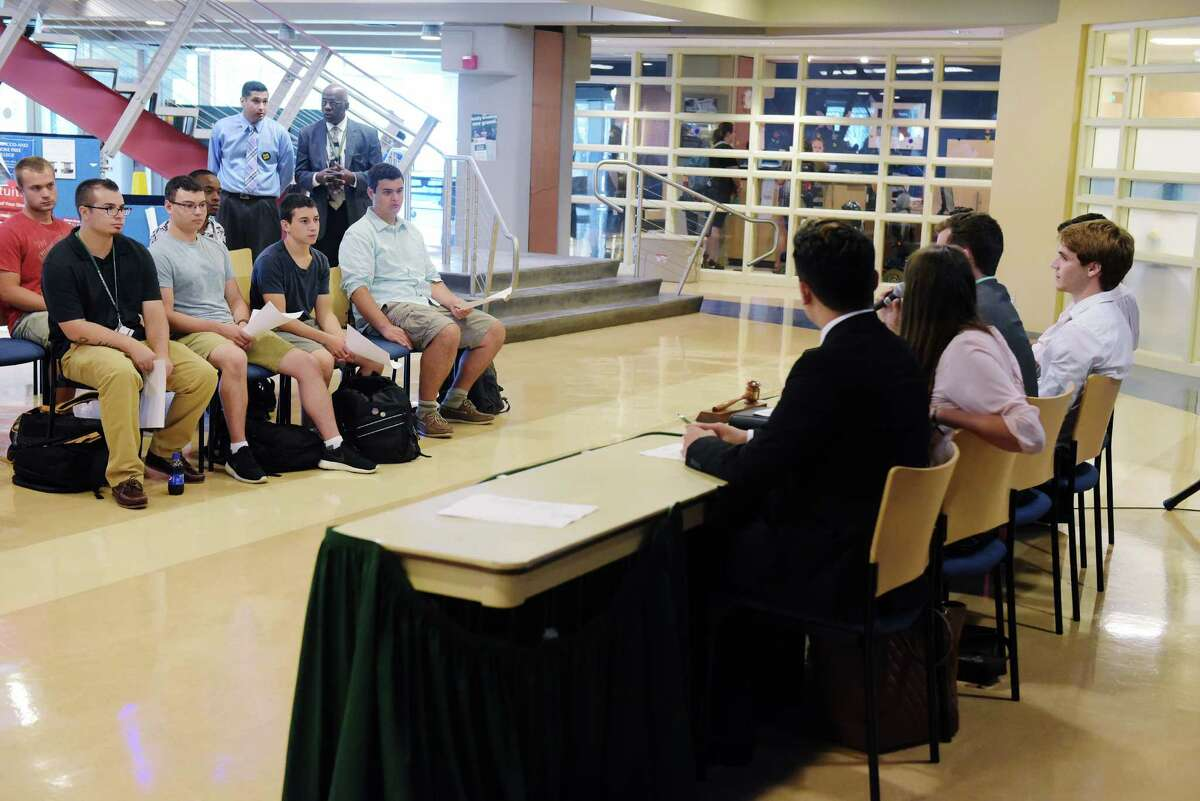 Hudson Valley Community College student government leaders and representatives hold a meeting in the lobby of the Siek Campus Center as part of the college's Welcome Week events for the start of the school year on Monday, Aug. 29, 2016, in Troy, N.Y. (Paul Buckowski / Times Union)