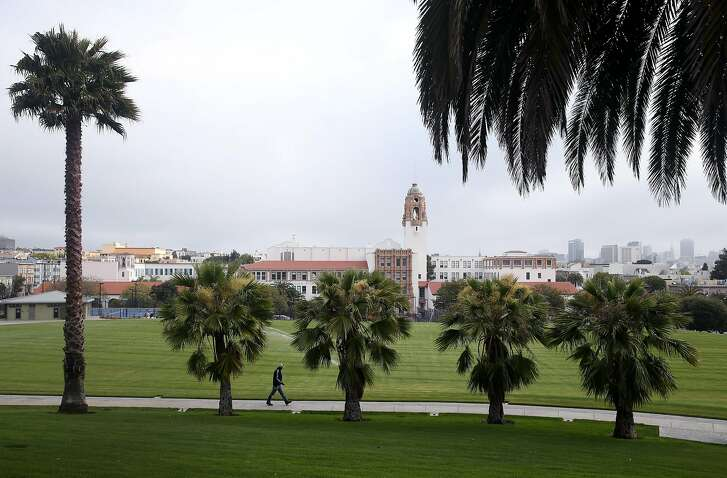 Samuel Martin walks through Mission Dolores Park to check the irrigation system before the park is reopened to the public in San Francisco, Calif. on Thursday, June 18, 2015. The more popular northern section of the park was fenced off in March 2014 to undergo an extensive renovation project. The second phase of the restoration is already beginning on the southern half of the park.