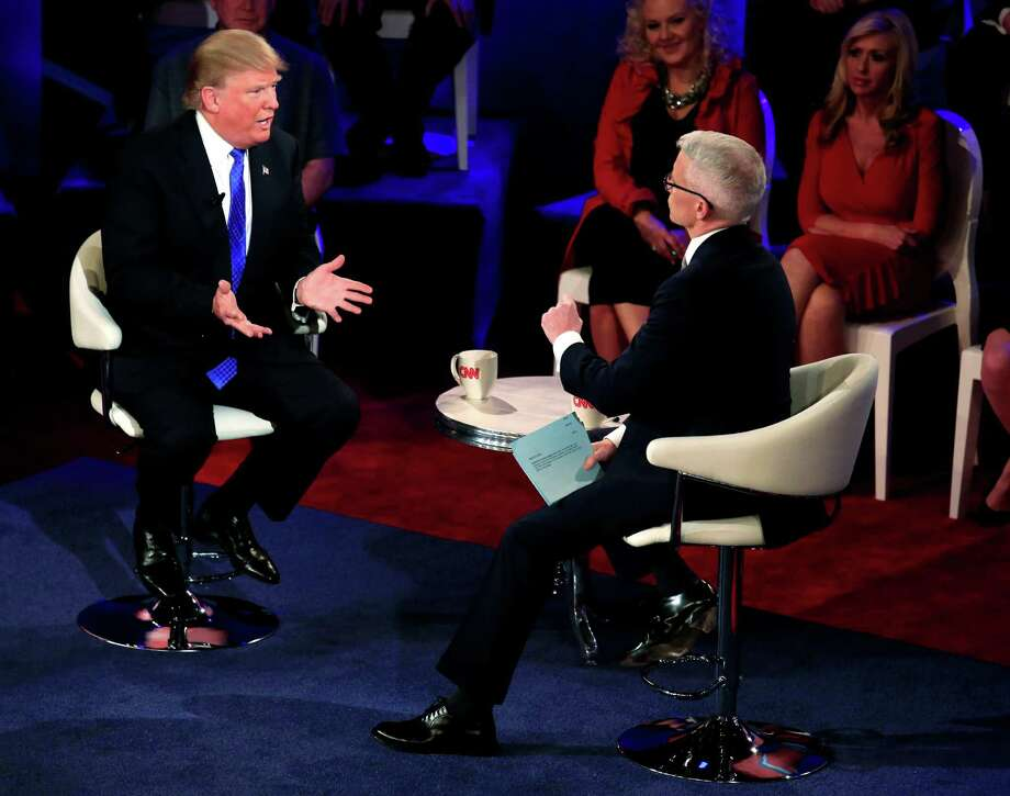 CNN anchor Anderson Cooper, right, served as moderator during a town hall event with Republican Presidential candidate Donald Trump. Photo: Darren Hauck, Stringer / 2016 Getty Images