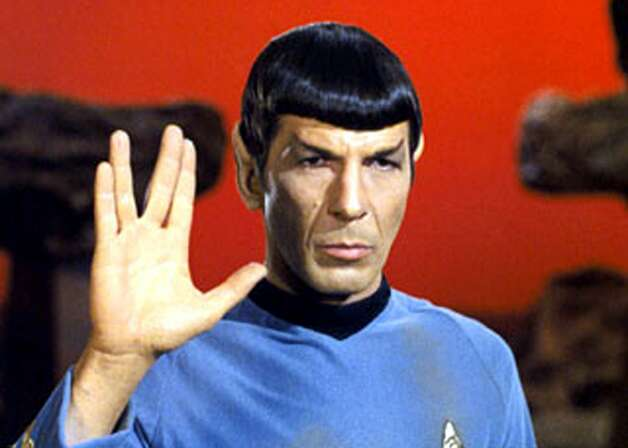 """Leonard Nimoyplayed the emotionally composed Mr. Spock, the chief science officer and second in command on the USS Enterprise. Here he is giving the """"live long and prosper"""" Vulcan salute in Episode 34: """"Amok Time."""" Photo: C.Paramount/Everett/REX, AP"""