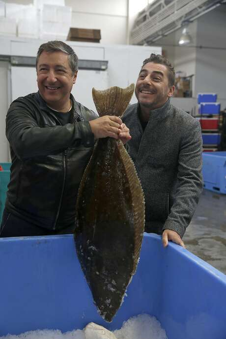 Chefs Joan (left) and Jordi Roca check out local fish at Two Sea on Pier 45. Photo: Liz Hafalia, The Chronicle