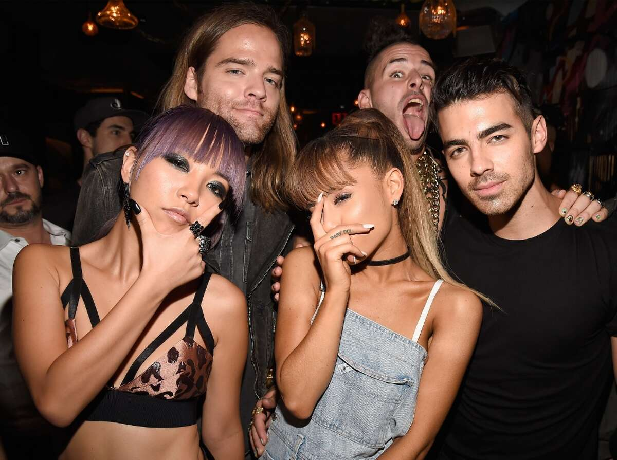 JinJoo Lee, Jack Lawles, Cole Whittle, and Joe Jonas of DNCE pose with singer Ariana Grande (C) duringthe 2016 MTV Video Music Awards Republic Records After Party on August 28, 2016 in New York City.