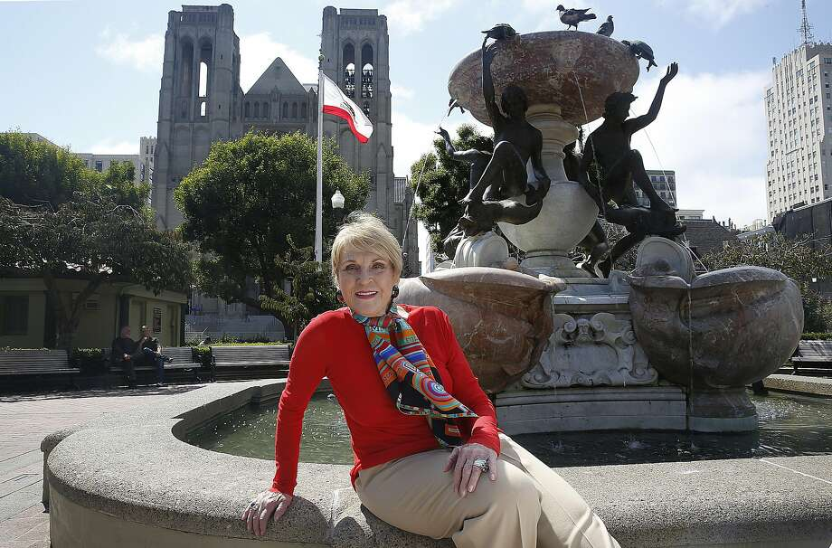 Lois Lehrman, who lives on Nob Hill and is seen in Huntington Park, with Grace Cathedral in the background, recently stepped down as publisher of the Nob Hill Gazette after selling it to businessman Clint Reilly. She spent 35 years at the high society magazine, five as ad director and 30 as publisher. Photo: Liz Hafalia, The Chronicle
