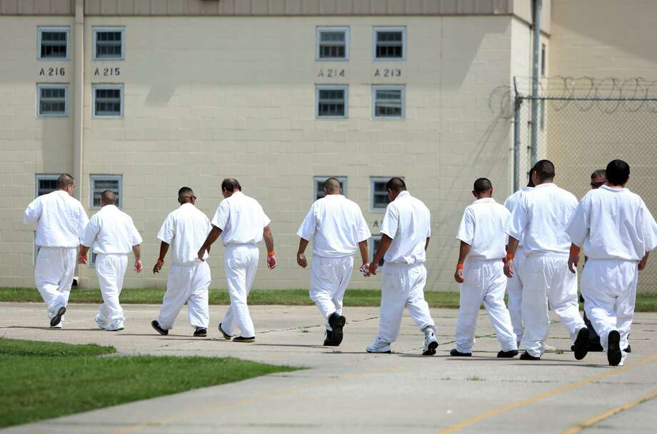 Inmates walk to their living quarters at the Texas Department of Criminal Justice's Hightower Unit in Dayton, Texas. (Chronicle file photo) Photo: Mayra Beltran, Staff / © 2014 Houston Chronicle