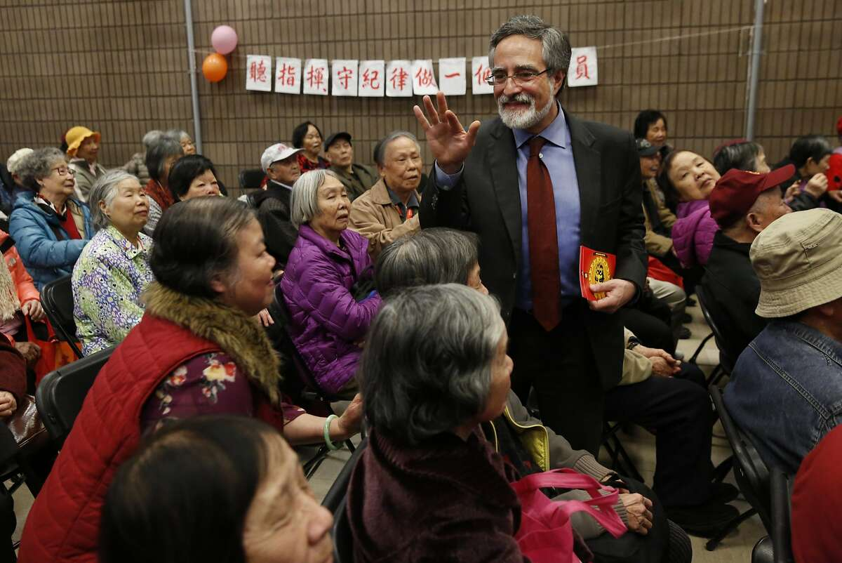 Supervisor Aaron Peskin greets community members after an event where the San Francisco Zoo & Gardens presented 300 seniors from the S.F. Community Tenants Association with free Zoo tickets at the Willie Woo Woo Wong Chinese playground Feb. 17, 2016 in San Francisco, Calif. The Zoo brought a kinkajou named Harley to the event.