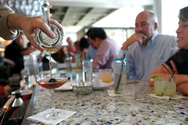 Folks enjoy happy hour at Caracol, Tuesday, July 12, 2016, in Houston. There has been a recent resurgence of happy hour in Houston.  ( Karen Warren  / Houston Chronicle )