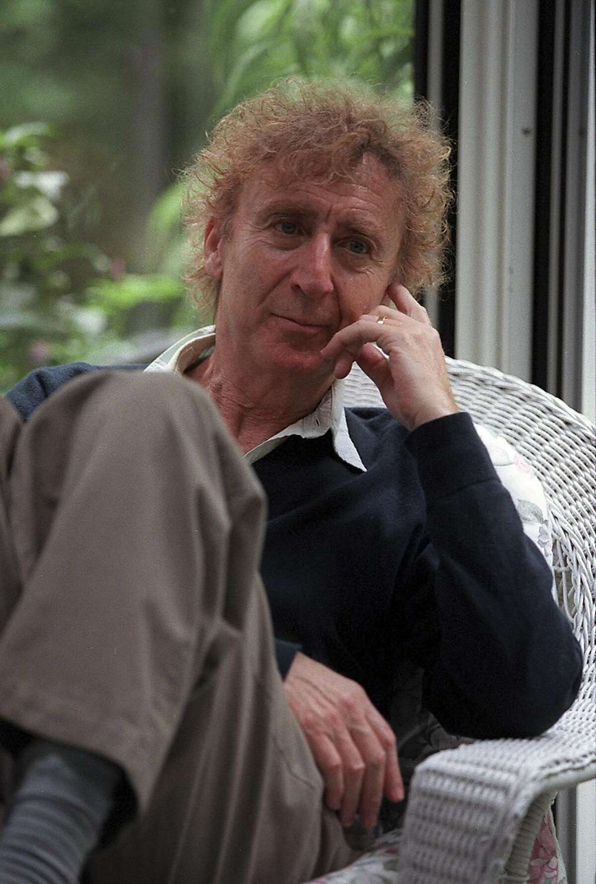 FILE -- Gene Wilder sits in the sun porch of his home in Stamford, Conn., Sept. 7, 1999. Wilder, who established himself as one of America's foremost comic actors with his delightfully neurotic performances in three films directed by Mel Brooks, his eccentric star turn in the family classic