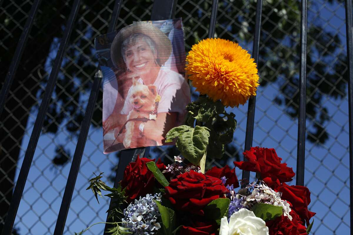 A memorial of flowers and candles for Oakland's 56th murder victim, Judy Salamon, sits on the sidewalk, Thursday July 25, 2013, on the 2400 block of Fern Street in Oakland, Calif. Salamon, 66, was killed while in her car Wednesday afternoon. Salamon, who was described as an avid pet lover, had lived in Oakland more than 30 years.