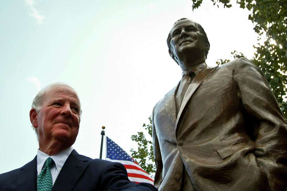 "Former Secretary of State James Baker III stands in front of the newly unveiled James A. Baker Monument during a dedication ceremony at the ""Baker Common"", a small portion of land at the corner of Sesquicentennial Park bounded by Smith and Preston and Buffalo Bayou, Tuesday, Oct. 26, 2010, in Houston.  A native Houstonian, James A. Baker, III, served as our nation's 61st Secretary of State.  The new statue looks towards a statue of President Bush, whose personal and political life was intertwined with Secretary Baker's.   ( Michael Paulsen / Houston Chronicle ) Photo: Michael Paulsen, Staff / Houston Chronicle"