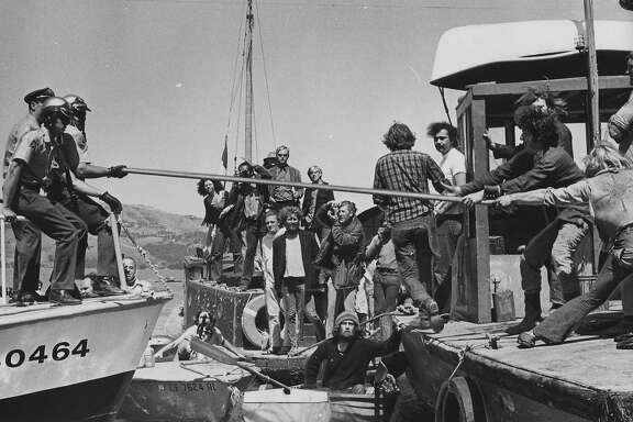 Sheriff's officers struggle with houseboat owners try to prevent them from moving a houseboat moored near  Sausalito  Photo shot 06/7/1971 Photo ran 06/8/1971,  p. 5