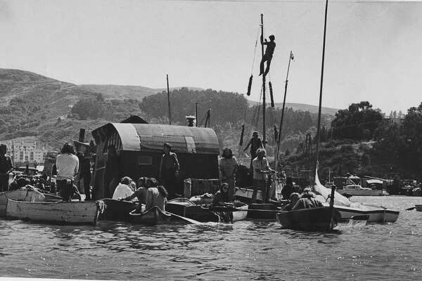 Several people in small boats canoes and kayaks try to prevent  Sheriff's officers, from moving a houseboat moored near  Sausalito  Photo shot 06/7/1971  Photo rsn 06/08/1971, p. 5