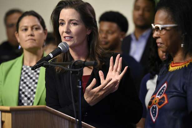 Mayor Libby Schaaf, center, is joined by City Administrator Sabrina Landreth, left, and President of the East Oakland Youth Development Center Regina Jackson, right, during a press conference announcing that the city is starting the search for a new police chief, at City Hall in Oakland, CA Monday, August 29, 2016.