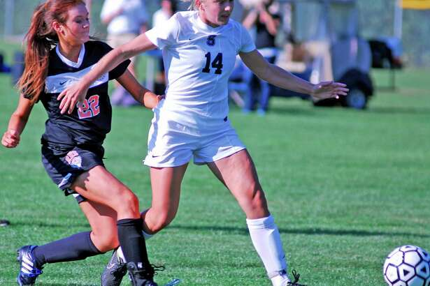 Staples' Lydia Shaw, right, shields the ball from Ridgefield's Kathryn Barlow during a game on Friday, Sept. 18th 2015 in Westport, Connecticut.