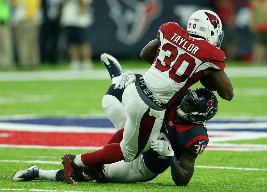 Texans rookie safety K.J. Dillon stops Elie Bouka for one of Dillon's eight tackles against the Cardinals on Sunday. Photo: Brett Coomer, Staff / © 2016 Houston Chronicle