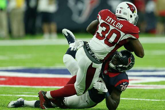Texans rookie safety K.J. Dillon stops Elie Bouka for one of Dillon's eight tackles against the Cardinals on Sunday.