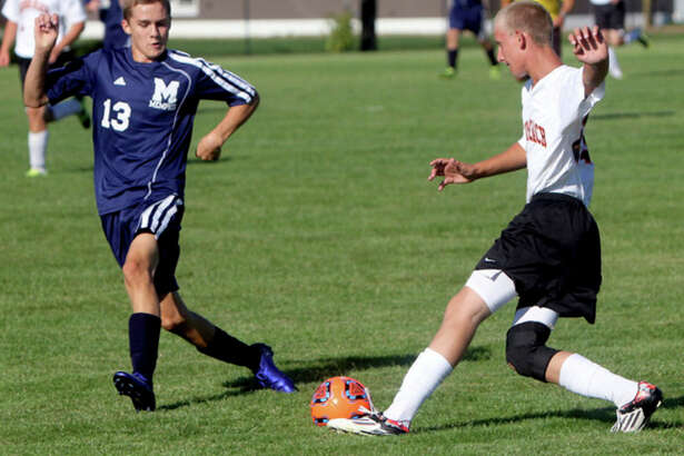 Seth Stapleton/Huron Daily Tribune   Harbor Beach's Jordan Siemen (25) works against Memphis' Ryan Vivian in the first half, Monday, in Harbor Beach.