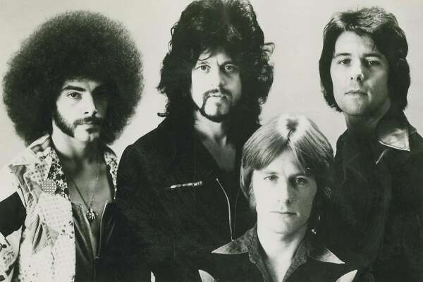 The band Journey in the mid-1970s. Neal Schon is on the far left.