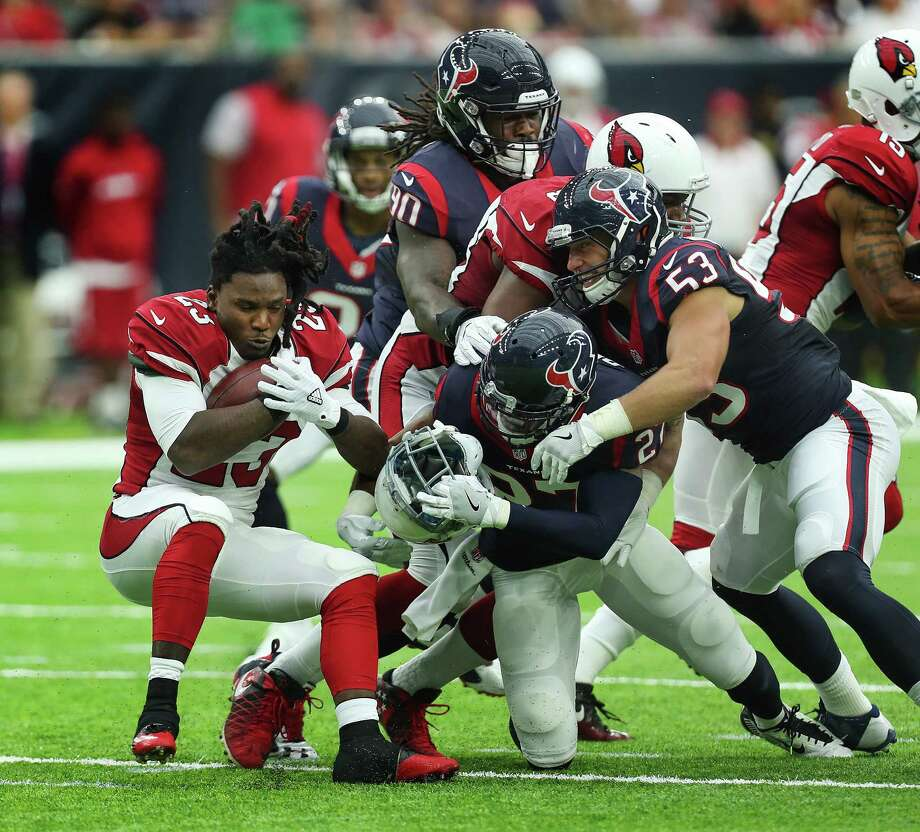 The Cardinals' Chris Johnson, left, runs into trouble against a Texans defense that will be even more formidable with the pending return of J.J. Watt. Photo: Steve Gonzales, Staff / © 2016 Houston Chronicle