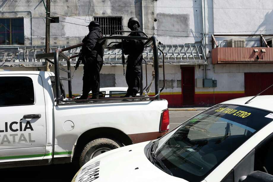 The Tamaulipas State Police patrols the downtown streets of Nuevo Laredo, Mexico, on Wednesday. A spate of violence has erupted throughout the border city as drug cartels fight for control. Photo: JERRY LARA, Staff / © 2016 San Antonio Express-News