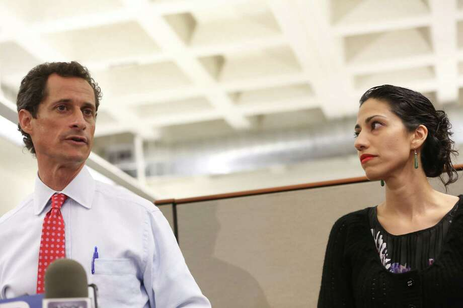 FILE-- New York City Mayoral candidate Anthony Weiner, with his wife Huma Abedin, during a news conference  where addressed revelations that he continued sending raunchy images of himself in online chats after his resignation from Congress in 2011, at the offices of Gay Men's Health Crisis in New York, July 23, 2013. Abedin announced on Aug. 29, 2016, that the couple were separating in the wake of a report that Weiner had been involved in another sexting scandal. (Michael Appleton/The New York Times) ORG XMIT: XNYT10 Photo: MICHAEL APPLETON / NYTNS