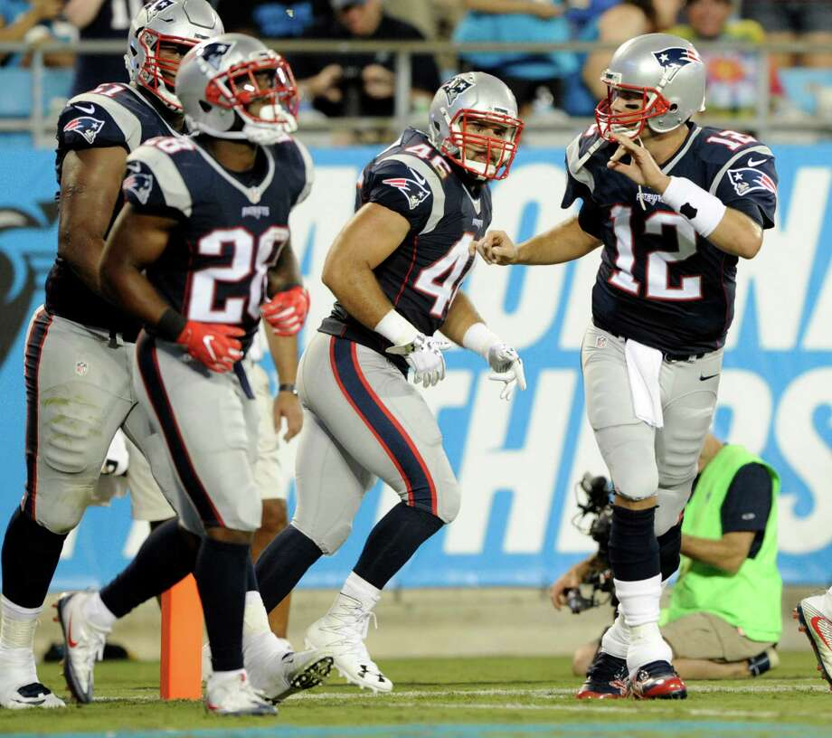 New England Patriots' Tom Brady (12) reacts after his touchdown pass against the Carolina Panthers during the first half of a preseason NFL football game in Charlotte, N.C., Friday, Aug. 26, 2016. (AP Photo/Mike McCarn) ORG XMIT: NCCB109 Photo: Mike McCarn / FR34342 AP