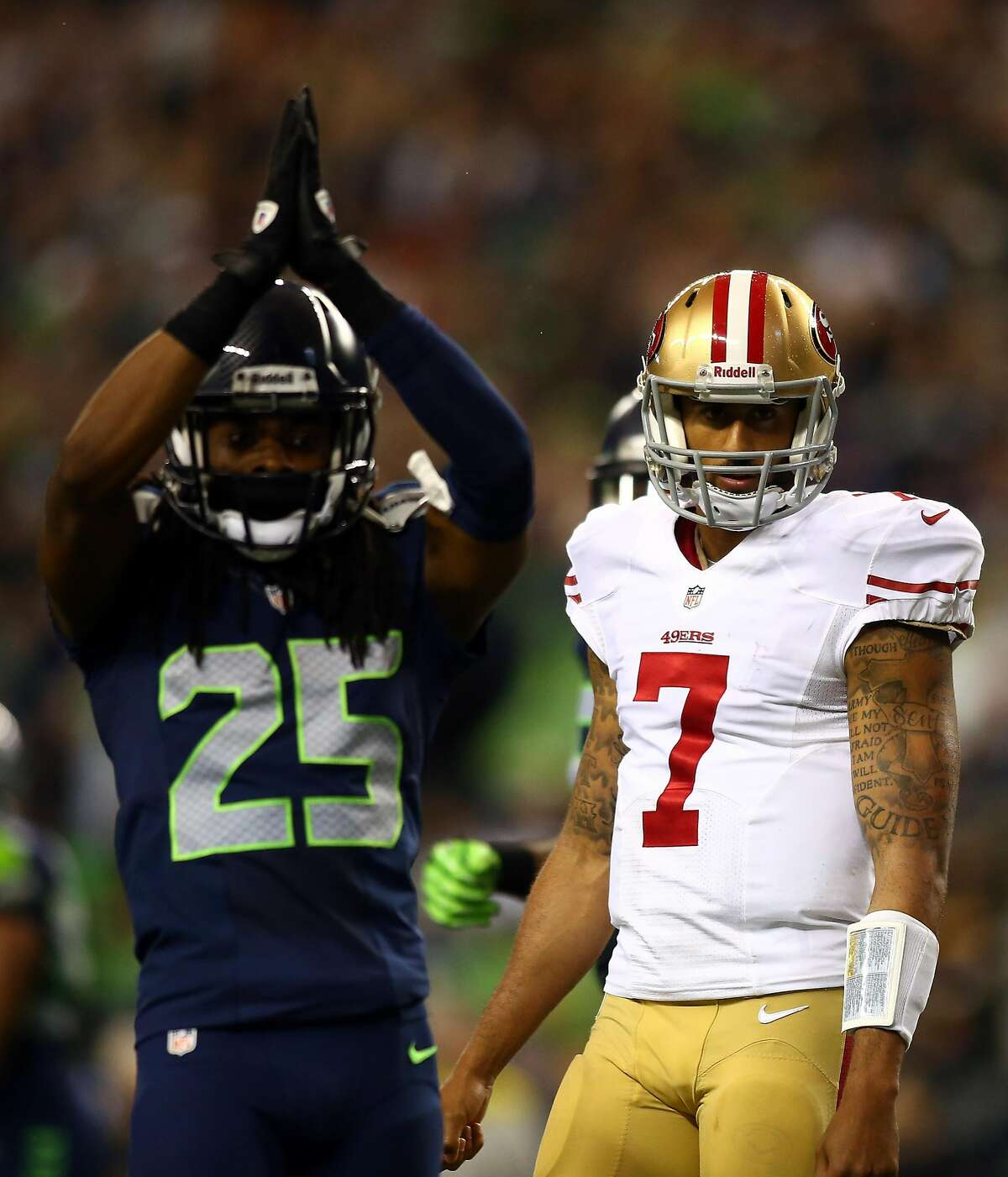SEATTLE, WA - SEPTEMBER 15: Colin Kaepernick #7 of the San Francisco 49ers looks on as Richard Sherman #25 of the Seattle Seahawks celebrates a saftey during their game at Qwest Field on September 15, 2013 in Seattle, Washington. (Photo by Jonathan Ferrey/Getty Images)