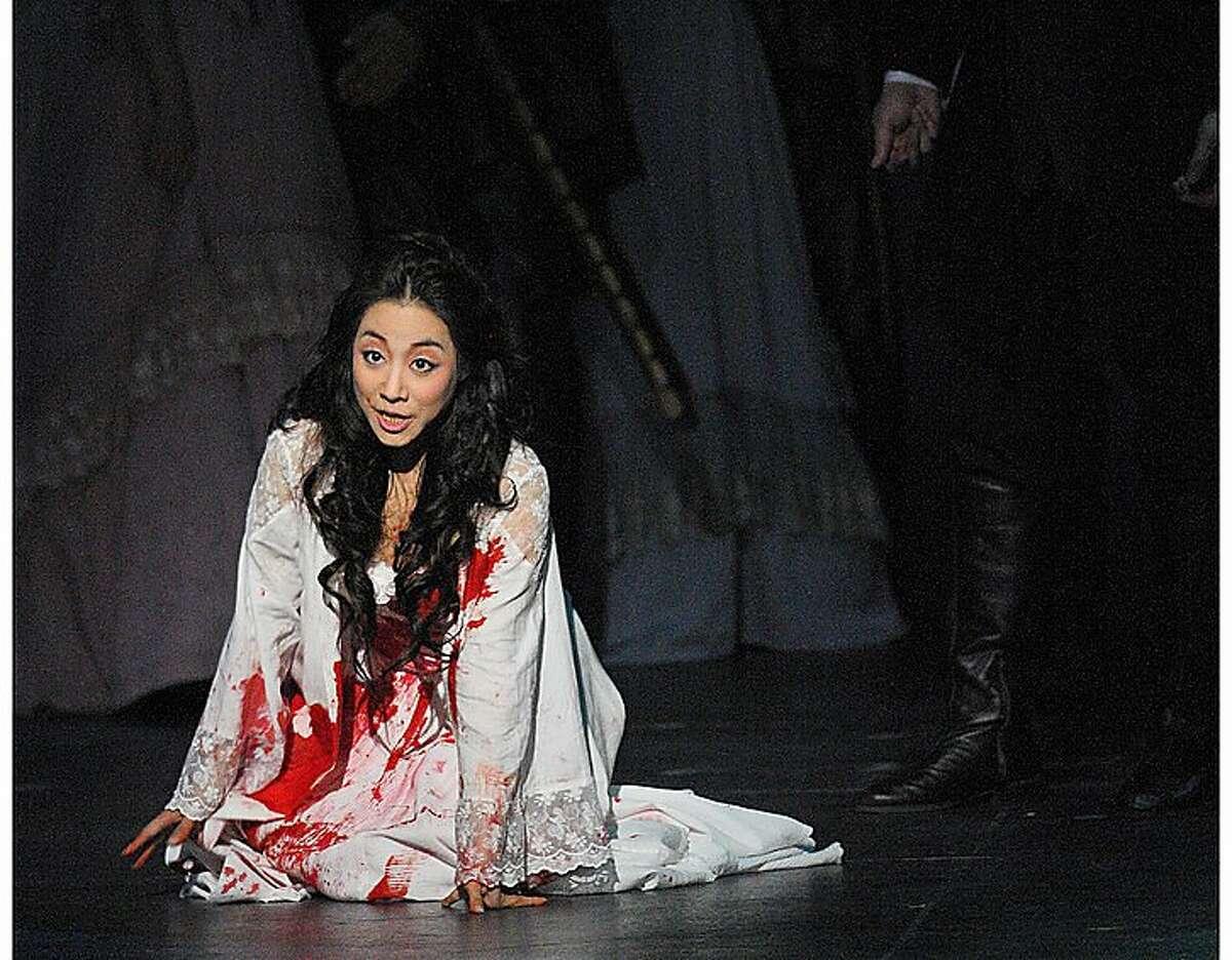 "Soprano Sylvia Lee in the title role of ""Lucia di Lammermoor"""