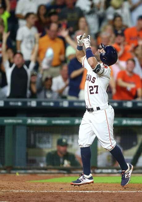 Astros second baseman Jose Altuve celebrates his sixth-inning homer Monday. Photo: Jon Shapley, Staff / © 2015  Houston Chronicle