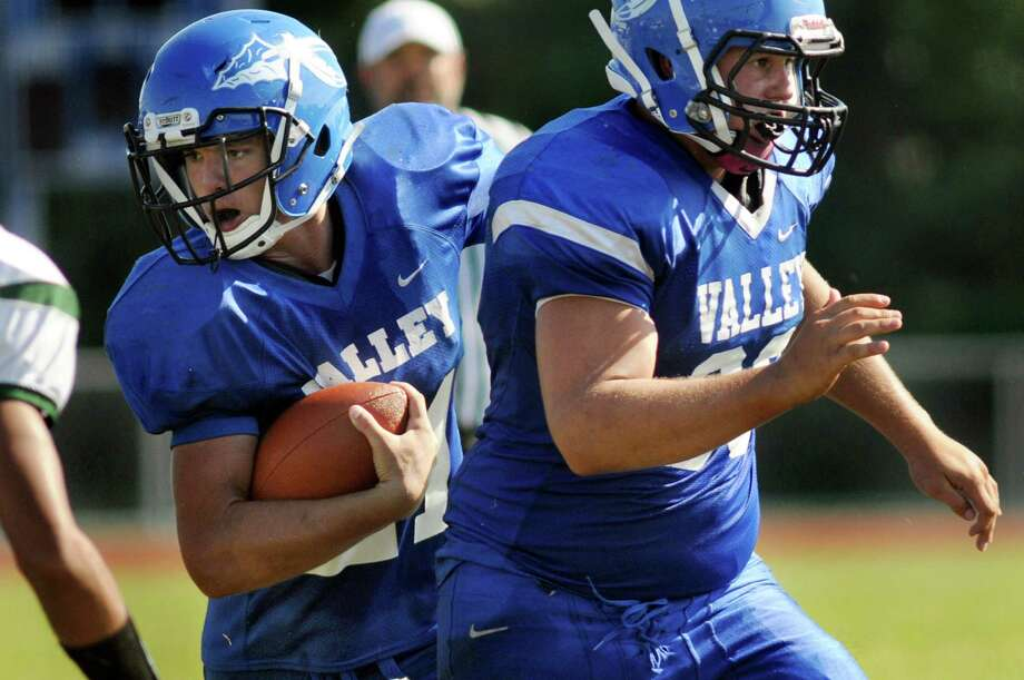 Hoosic Valley's Tom Madigan, left, receives protection from Jeff Carrozza during their football game against Greenwich on Saturday, Sept. 19, 2015, at Hoosic Valley High in Schaghticoke, N.Y. (Cindy Schultz / Times Union) Photo: Cindy Schultz / 00033404A