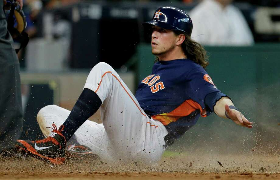 Houston Astros Colby Rasmus slides across home plate after scoring on a double hit by Carlos Gomez against the Los Angeles Angels during the third inning at Minute Maid Park Sunday, July 24, 2016, in Houston.  ( Melissa Phillip / Houston Chronicle ) Photo: Melissa Phillip, Staff / © 2016 Houston Chronicle