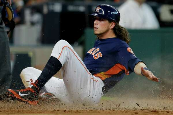 Houston Astros Colby Rasmus slides across home plate after scoring on a double hit by Carlos Gomez against the Los Angeles Angels during the third inning at Minute Maid Park Sunday, July 24, 2016, in Houston.  ( Melissa Phillip / Houston Chronicle )