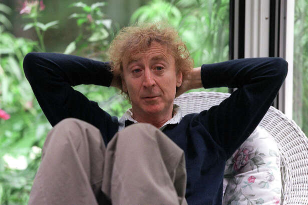 "FILE -- Gene Wilder sits in the sun porch of his home in Stamford, Conn., Sept. 7, 1999. Wilder, who established himself as one of America's foremost comic actors with his delightfully neurotic performances in three films directed by Mel Brooks, his eccentric star turn in the family classic ""Willy Wonka and the Chocolate Factory"" and his winning chemistry with Richard Pryor in the box-office smash ""Stir Crazy,"" died on Aug. 29, 2016. He was 83. (Joyce Dopkeen/The New York Times) ORG XMIT: XNYT72"