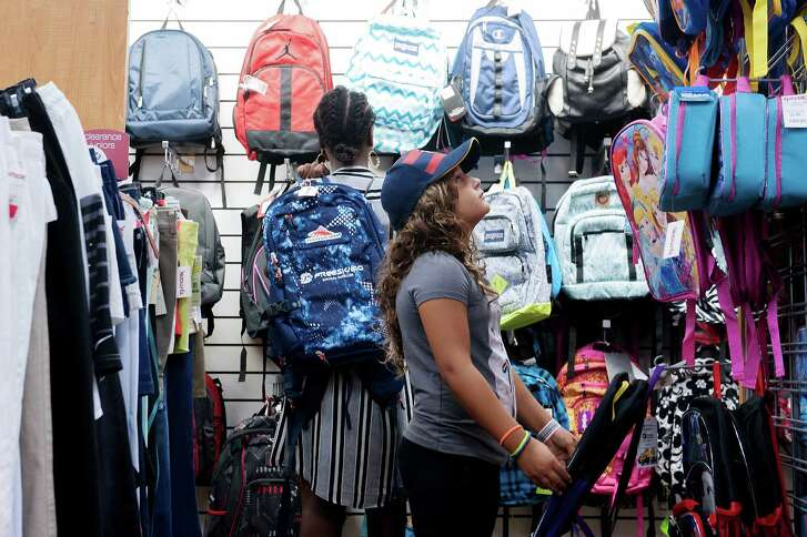 Leilani McCray, left, and Sofia Dean shop for backpacks at TJ Maxx, in New York.