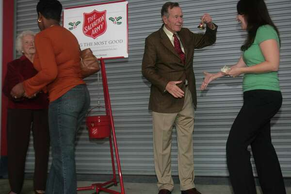 Former president George H.W. Bush rings a bell for the Salvation Army. Bush and former first lady Barbara Bush made an appearance to promote the last week of the Salvation Army's 2006 Red Kettle Christmas Campaign at Gallery Furniture on Monday, Dec. 18, 2006 in Houston, TX.   Photo by Mayra Beltran / Houston Chronicle