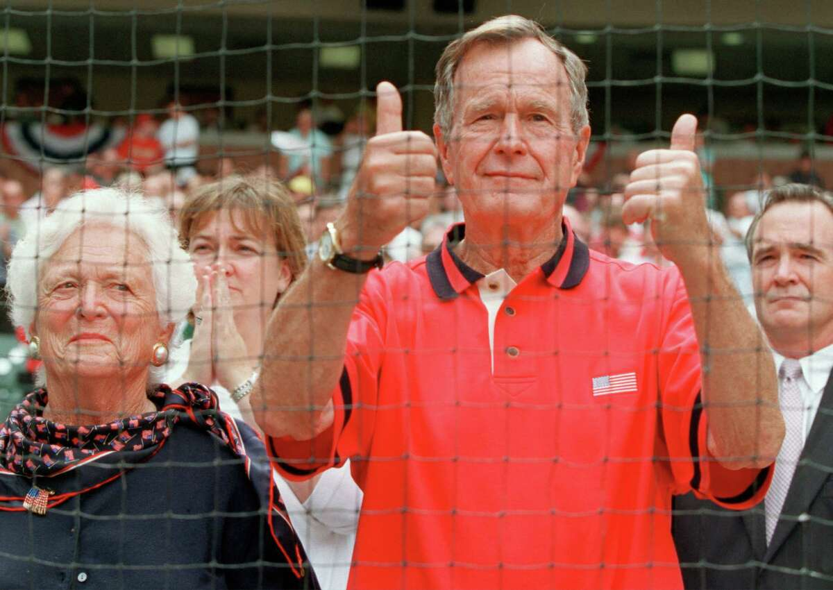Former President George Bush gives the thumbs-up during the opening ceremony prior to the Astros postseason opener against Atlanta at Enron Field. on October 9,2001.