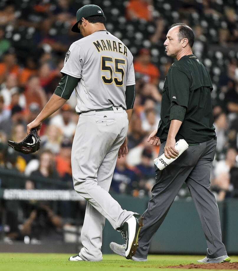 Oakland Athletics starting pitcher Sean Manaea (55) walks to the dugout with a trainer after being pulled from the game in the fourth inning against the Houston Astros, Monday, Aug. 29, 2016, in Houston. Photo: Eric Christian Smith, Associated Press
