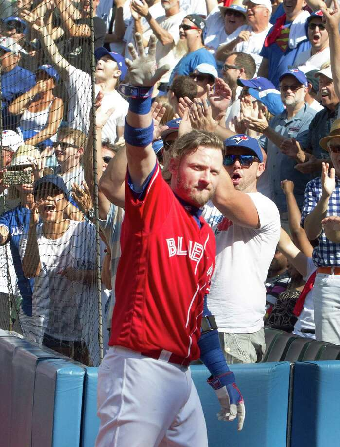 Toronto Blue Jays' Josh Donaldson takes a curtain call after his third home run of a baseball game against the Minnesota Twins in Toronto, Sunday, Aug. 28, 2016. (Fred Thornhill/The Canadian Press via AP) ORG XMIT: FJT109 Photo: Fred Thornhill / The Canadian Press