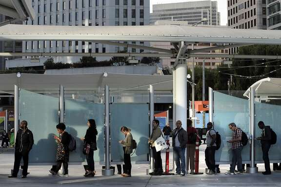 Passengers wait in line for a bus at the Temporary Transbay Terminal in San Francisco , Calif., on Monday, August 29, 2016.