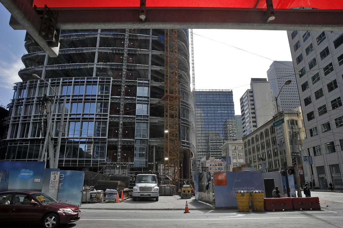 A car drives by the location of a new proposed plaza tucked into the southwest corner of the intersection of Mission and Fremont Streets next to the new Salesforce Tower in San Francisco, Calif., on Monday, August 29, 2016.