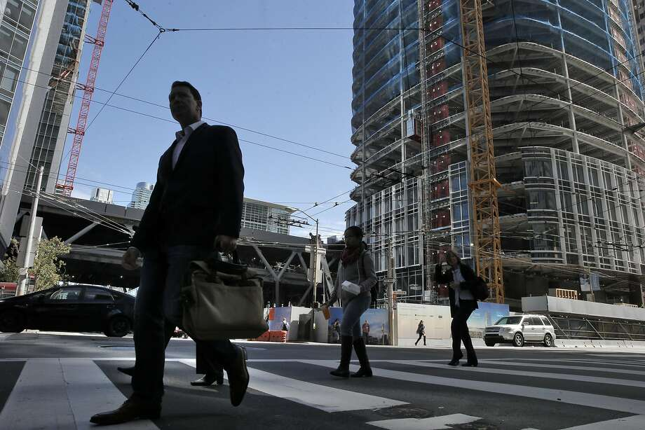 Pedestrians walk by the location of a new proposed plaza tucked into the southwest corner of the intersection of Mission and Fremont streets in San Francisco. Photo: Carlos Avila Gonzalez, The Chronicle