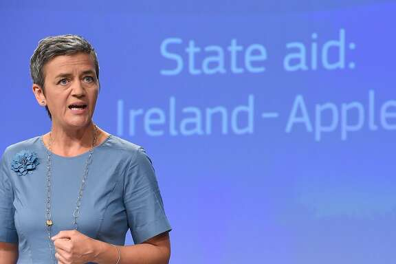EU Competition Commissioner Margrethe Vestager talks as she gives a press conference to order Apple to pay 13 billion euros in back taxes, in Brussels on August 30, 2016.  The European Union on August 30, 2016, ordered Apple to pay a record 13 billion euros in back taxes in Ireland, saying deals allowing the US tech giant to pay almost no tax were illegal. Apple and the Irish government immediately said they would appeal against the European Commission ruling, while the US Treasury said it could undermine its economic partnership with the EU. Ireland has been seeking to attract multinationals by offering extremely favourable tax conditions, known as sweetheart deals, but EU Competition Commissioner Margrethe Vestager said Apple's broke EU laws on state aid.  / AFP PHOTO / John THYSJOHN THYS/AFP/Getty Images
