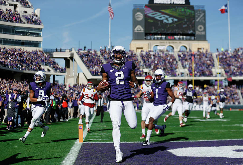 FILE — Quarterback Trevone Boykin of the TCU Horned Frogs scores on a 55 yard touchdown reception against the Iowa State Cyclones during the first quarter of the Big 12 college football game at Amon G. Carter Stadium on December 6, 2014 in Fort Worth, Texas.  (Photo by Christian Petersen/Getty Images) Photo: Christian Petersen/Getty Images
