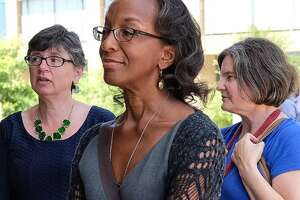 Lisa Moore, left, and fellow University of Texas faculty members Mia Carter and Jennifer Lynn Glass filed suit to at least retain the option of barring guns from their classrooms (Aug. 4, 2016 photo by Rodolfo Gonzalez, Austin American-Statesman).