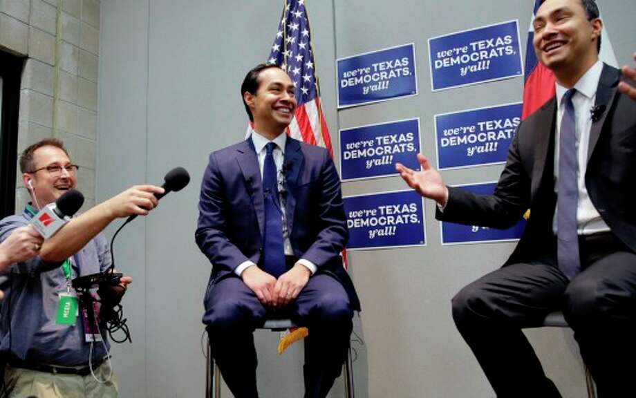 Housing and Urban Development Secretary Julian Castro, left, smiles with his brother during the Texas Democratic Party convention where the secretary made claims comparing the California and Texas economies (Associated Press photo, Eric Gay). Photo: Eric Gay / Copyright 2016 The Associated Press. All rights reserved. This material may not be published, broadcast, rewritten or redistribu