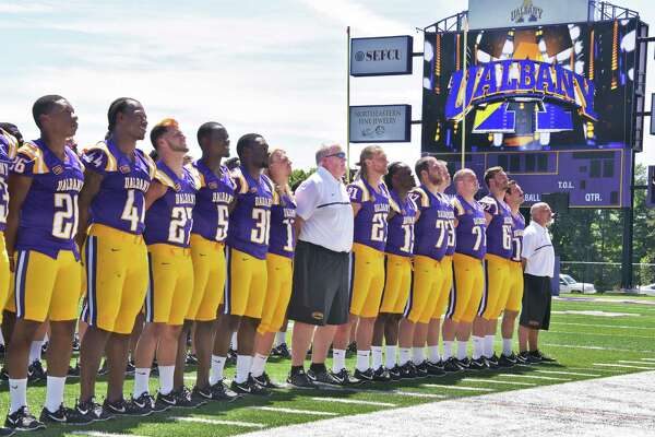 Head coach Greg Gattuso, center, and players pose for team photos during UAlbany football media day at Casey Stadium Tuesday Aug. 9, 2016 in Albany, NY.  (John Carl D'Annibale / Times Union)