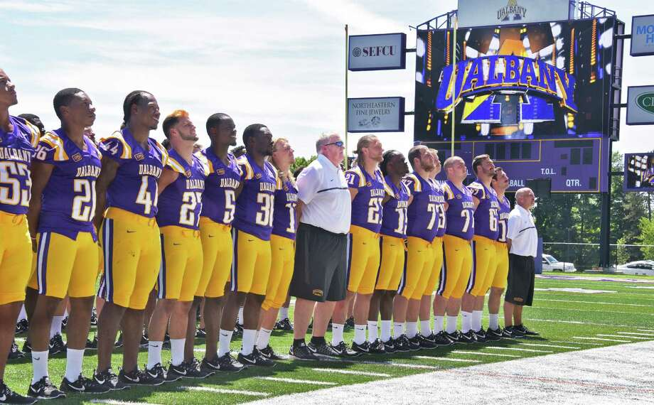 Head coach Greg Gattuso, center, and players pose for team photos during UAlbany football media day at Casey Stadium Tuesday Aug. 9, 2016 in Albany, NY.  (John Carl D'Annibale / Times Union) Photo: John Carl D'Annibale / 20037549A