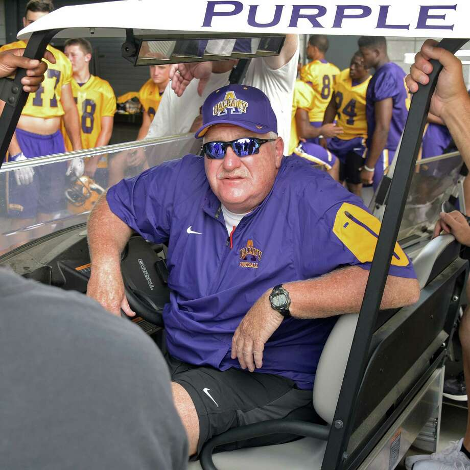 UAlbany Head Coach Greg Gattuso and his team wait out the rains before practice at Casey Stadium Saturday Aug. 13, 2016 in Albany, NY.  (John Carl D'Annibale / Times Union) Photo: John Carl D'Annibale / 20037644A