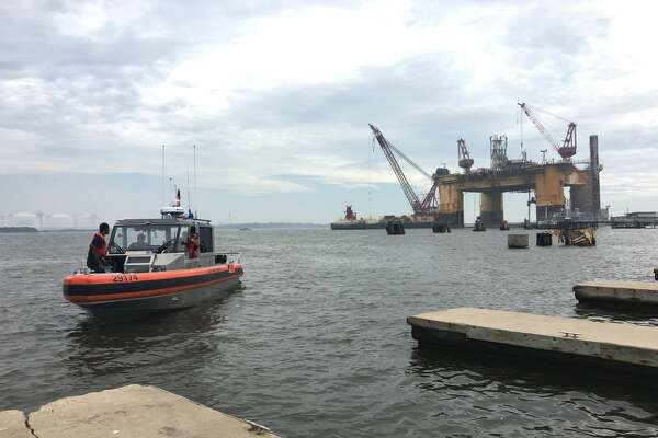 The Port Arthur Police Department, Jefferson County Sheriff's Office and U.S. Coast Guard are searching for a man who fell about 100 feet into the water from a rig near Sabine Pass Tuesday morning.