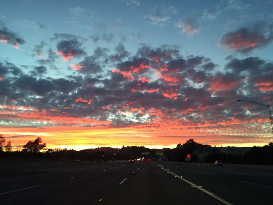 View of spectacular sunset Monday afternoon from I-680 in Walnut Creek. National Weather Service officials said upper level moisture from Hurricane Madeline off the Coast of Hawaii was mixed with smoke from the Soberanes Fire near Big Sur to produce the colorful sunset. Photo: Evan Sernoffsky / The Chronicle / /