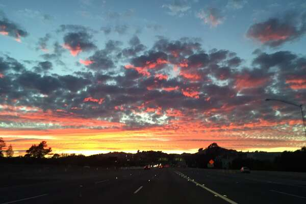 View of spectacular sunset Monday afternoon from I-680 in Walnut Creek. National Weather Service officials said upper level moisture from Hurricane Madeline off the Coast of Hawaii was mixed with smoke from the Soberanes Fire near Big Sur to produce the colorful sunset.